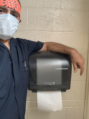 2020-07-14 - Jai installs paper towel dispenser in bathroom at Booth